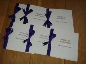 Folded wedding invite in Purple