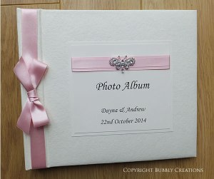 wedding photo album with butterfly in pink