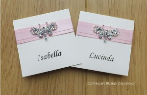 butterfly wedding place cards in pink