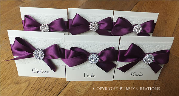 wedding guest name cards, place cards in aubergine, dark purple with lace and sparkly embellishment
