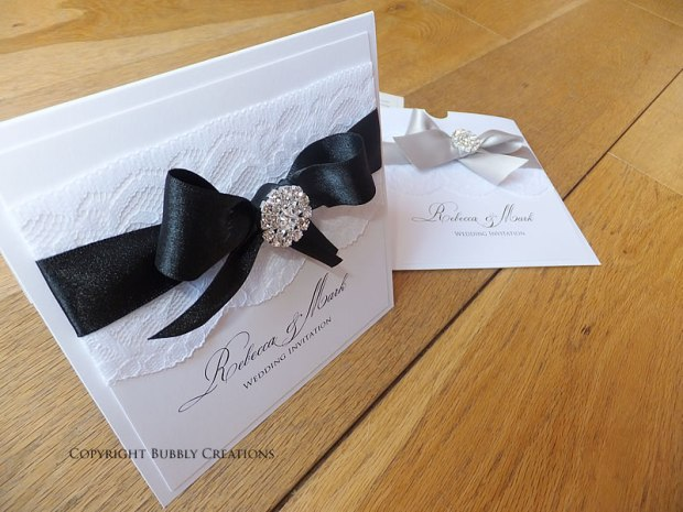 Lace and diamante wedding invitation black, silver.