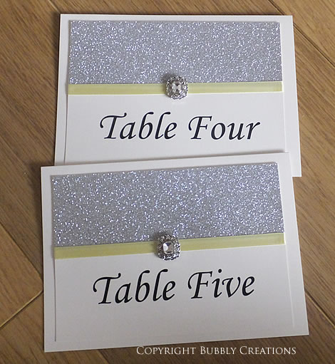 wedding table number cards. Silver, glitter, yellow. Sparkly.