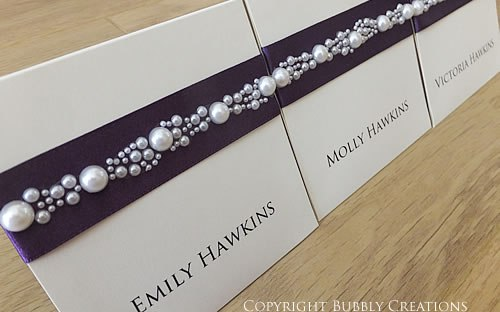 luxury handmade wedding place cards with pearls in dark purple