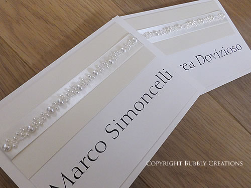 pearl wedding table name cards in ivory